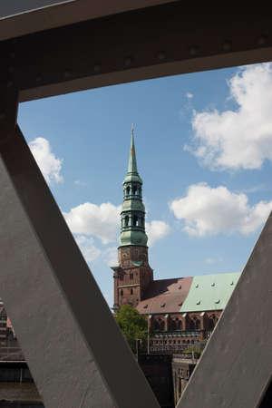 mooring bollards: Church photographed through the bridge framework Stock Photo