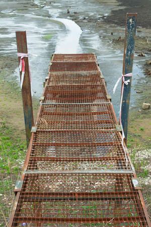 trickle down: Old rusty bridge that leads to nowhere