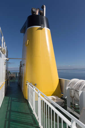 doldrums: Yellow chimney on the ferry to r