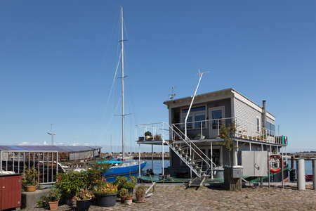 mooring bollards: Multi-story house boat in the port of Aeroeskoebing Editorial