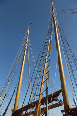 shrouds: Masts and rigging of a two-master at the port of Aeroeskoebing Stock Photo