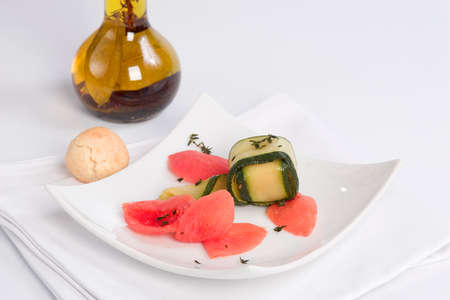 bisquit: Zucchini cubes with melted tomatoes and Bisquit Stock Photo