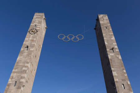 Columns with Olymischen rings at the entrance to the Olympic Stadium Editorial