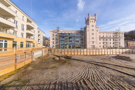 piling: Large Construction site in front of the restored buildings on Leipziger Strasse Editorial
