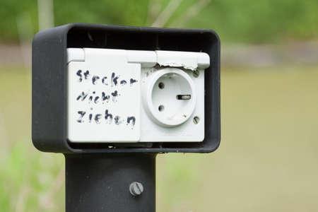 defective: Damaged or detached socket with inscription