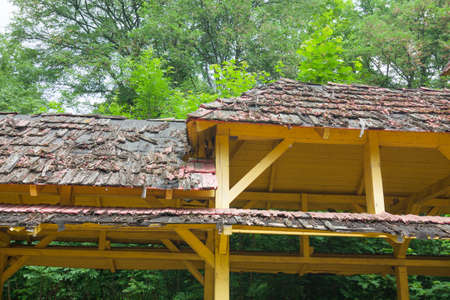 wooden beams: Dilapidated roof of wooden beams and roof tiles