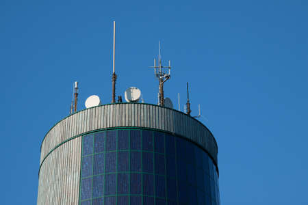 spire: Spire with telephone antennas and satellite dishes