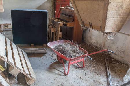 inoperative: Old wheelbarrow in an abandoned pigsty in Tryggelev, Denmark