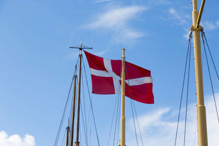 shrouds: Danish flag, Dannebrog, on a sailing ship in the harbor of Svendborg