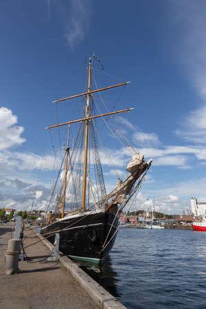 mooring bollards: Black painted sailing ship in the ferry port of Svendborg, Fyn, Denmark