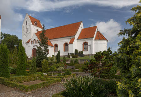 Church of Lindelse in the middle of the cemetery Stock Photo