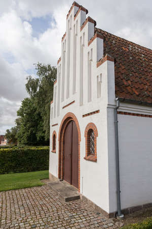 pitched roof: Facade of the chapel in Lindelse Stock Photo