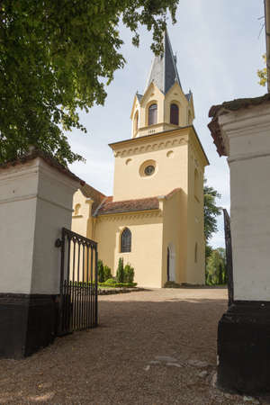 pitched: Church photographed by the entrance to the cemetery