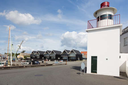Small lighthouse in the port of Lohals on Langeland Editorial