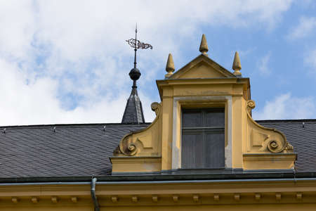 roof ridge: Skylight on a roof of a manor house Stock Photo