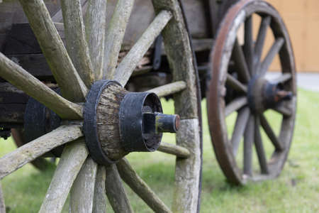 spokes: Wheels of a horse carriage with spokes and axles