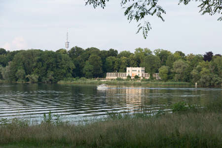 lodge: Jungfernsee with boat in front of the Berlin hunting lodge Stock Photo