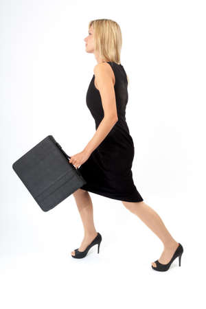 stride: Young woman with briefcase charging forward