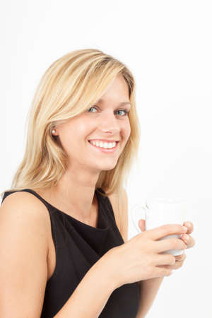 coffee breaks: Young woman with coffee cup looking at the camera Stock Photo