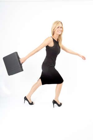 stride: Young woman with briefcase running to the right