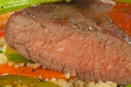 carnes y verduras: Cordero al horno con arroz y salsa de tomate