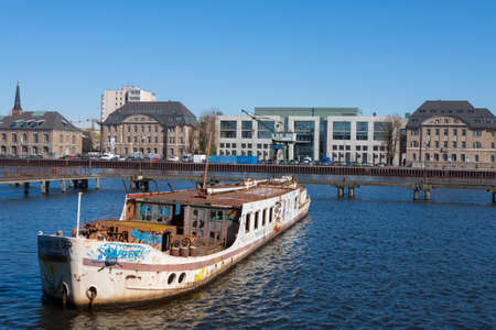 treptow: Old boat on the River Spree before new buildings Stock Photo