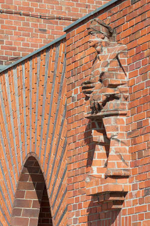 alt: Workers Statue of brick masonry at the former factory gate