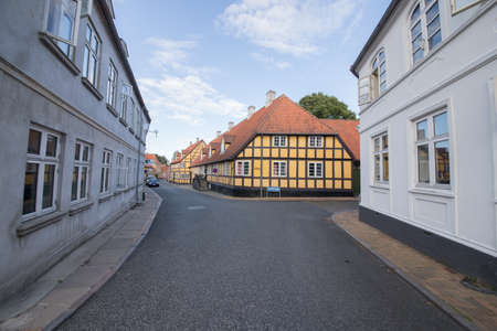 pitched roof: Yellow half-timbered house in the City of Rudkoebing Stock Photo