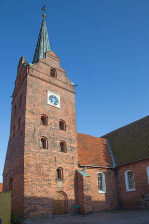 exterior architectural details: Church tower and annex building of the church in Rudkoebing