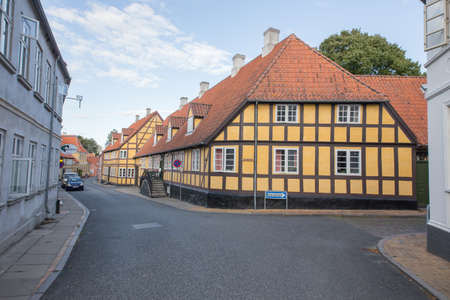 pitched roof: Yellow half-timbered house in the City of Rudkoebing Editorial