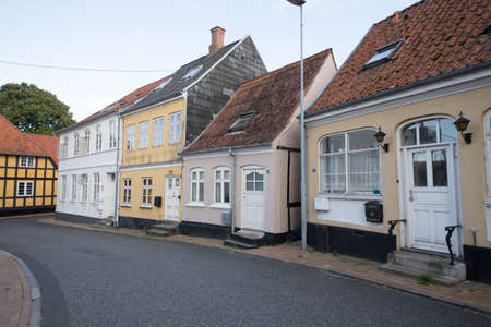 pitched roof: Four small houses in a street in Denmark Rudkoebing