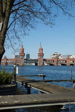 treptow: Empty lands in the Spree river in front of the Oberbaum bridge Editorial