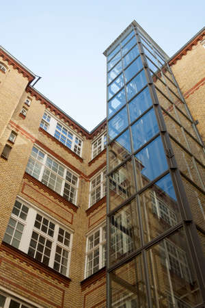 treptow: Glass elevator in an old building in Berlin Editorial