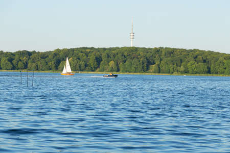 pleasure craft: Sailing and motor boat on the Jungfernsee. TV tower in the background