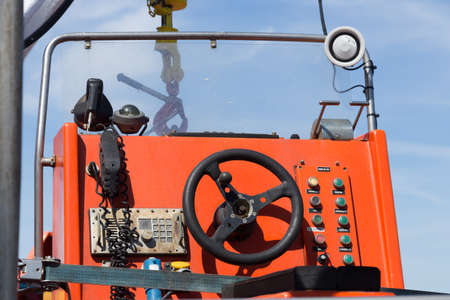 unkempt: control stand of a lifeboat on deck of a car ferry