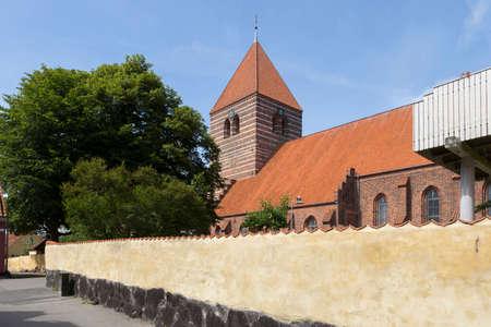 perimeter: church of Stege behind the perimeter wall