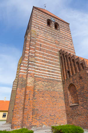 totaled: Massive tower of the church in Stege on the island Moen