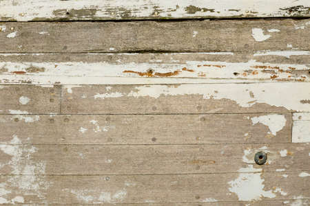 holey: Dilapidated planks of a wooden motorboat with paint remains