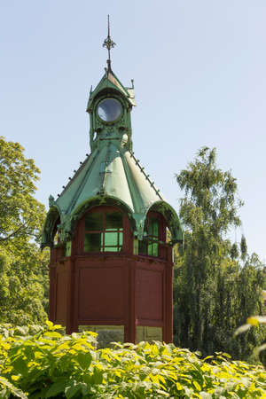 verdigris: Red tower in a park at Nysted Lolland Denmark