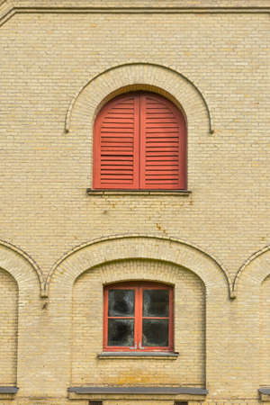 exterior architectural details: Windows and shutters in a small building on Fuglsang