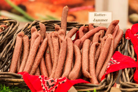 specialty: Sausage specialty in a basket on a market stall