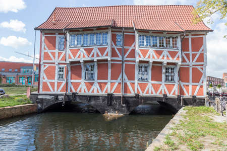 timbered: Timbered house on a bridge over the Muehlenbach in Wismar Mecklenburg-Vorpommern