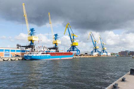 mooring bollards: Five large industrial cranes in the port of Wismar Mecklenburg-Vorpommern