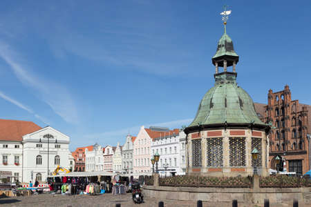 verdigris: Building of the water art on the market of Wismar Mecklenburg-Vorpommern Editorial