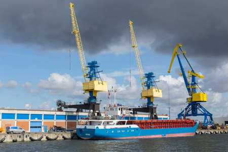 mooring bollards: Three large industrial cranes in the port of Wismar Mecklenburg-Vorpommern