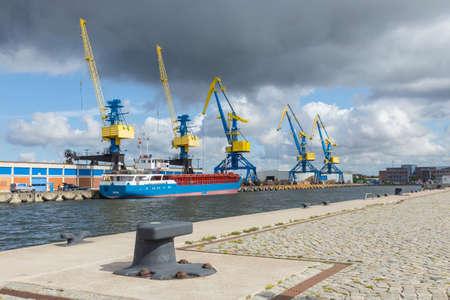 Five large industrial cranes in the port of Wismar Mecklenburg-Vorpommern