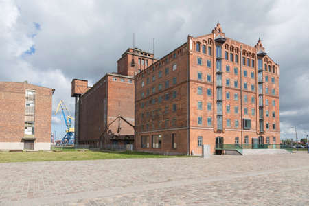 many windows: Big, old harbor warehouse brick building with many windows in the port of Wismar