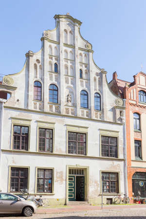 house gable: White House with a curved gable in Wismar Mecklenburg-Vorpommern