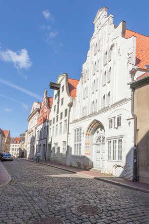 house gables: Narrow cobblestone street in downtown Wismar Mecklenburg-Vorpommern