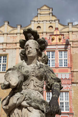 stoop: Heavily weathered statue of a woman in front of the Castle of Bernburg Saxony-Anhalt Editorial